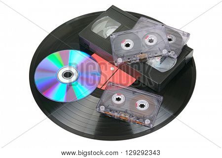 Vinyl disc, audio and video cassettes isolated on white background