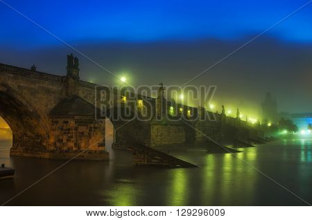 Charles bridge foggy night in Prague Czech republic