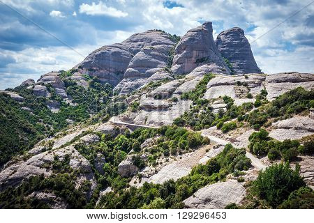 tourist trail in Montserrat mountains near Maria de Montserrat Abbey Spain