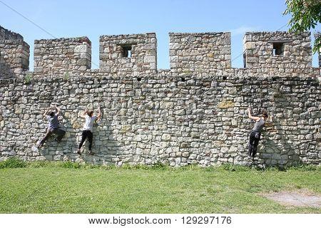 Belgrade, Serbia - April, 23, 2016: People practicing free climbing on the walls of Belgrade medieval fortress Kalemegdan