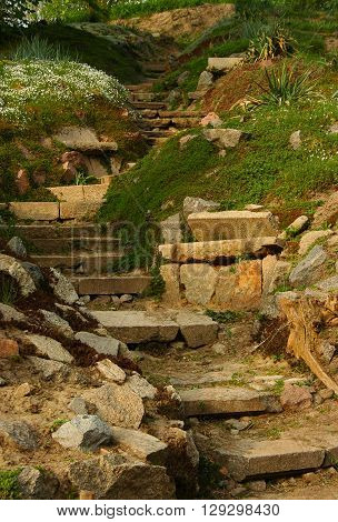 Stone stairs rock garden plants flowers bushes