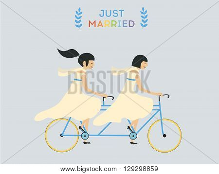 Just married lesbian wedding couple riding bicycle