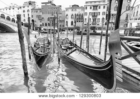 Gondolas on Grand Canal near Realto bridge in Venice, Italy. Black and white