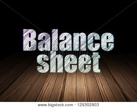 Banking concept: Glowing text Balance Sheet in grunge dark room with Wooden Floor, black background