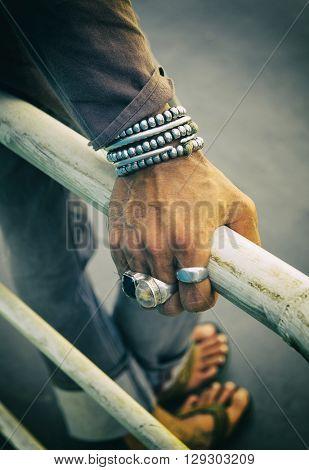 Hippie silver bracelet on a man's hand. Cross process