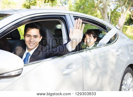 business man with daughter driving car go to work and school