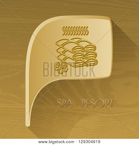 Vector bubble golden icon with spa accessory towels on brown wooden background. Spa resort.