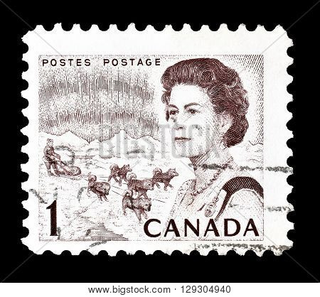 CANADA - CIRCA 1967 : Cancelled postage stamp printed by Canada, that shows Northern lights, dog team and queen.