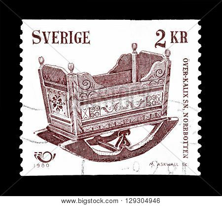 SWEDEN - CIRCA 1980 : Cancelled postage stamp printed by Sweden, that shows Antique cradle.