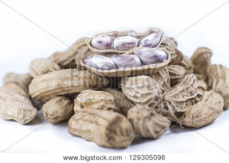 Boiled peanuts on a white background See review