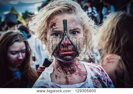 WARSAW POLAND - JUNE 27 2015: Participant of the 9th Zombie Walk walks on street in Warsaw city center