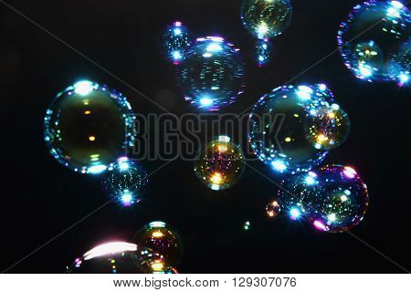 Blurred colorful air bubbles from the soap bubbles on background.