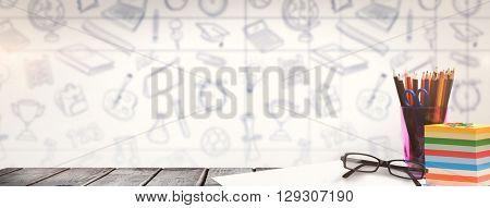 School supplies on desk against school doodles