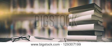 Desk against library shelf
