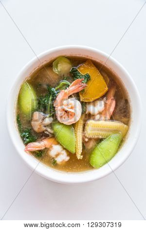 Thai Spicy Mixed Vegetable Soup with Prawns, on white background