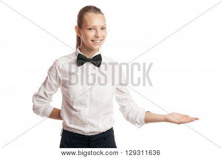 Smiling waitress offering something with arm.Studio shot.Isolated.