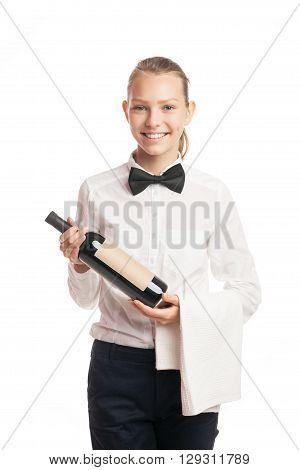 Portrait of beautiful smiling waitress holding bottle of wine