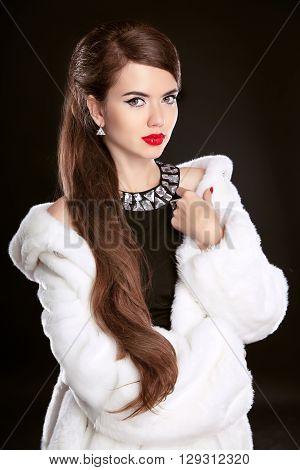 Beautiful Fashion Lady In Luxury Fur Coat And Elegant Black Dress Isolated On Black Background. Hair