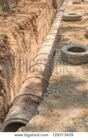underground drainage concrete pipe in construction site selective focus