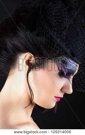 charming woman with dark makeup, profile face with veil