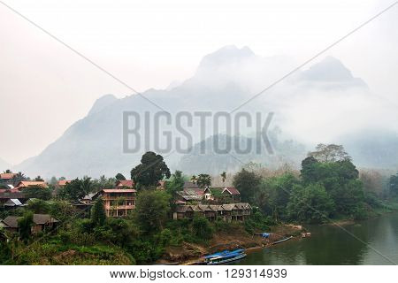 Blurry Fog Morning With An Image Of A Mountain Lake And Haze At Nong Khiaw, Laos