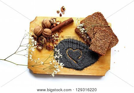 A delicious combination of bread, nuts, poppy seeds and cinnamon on a wood plaque