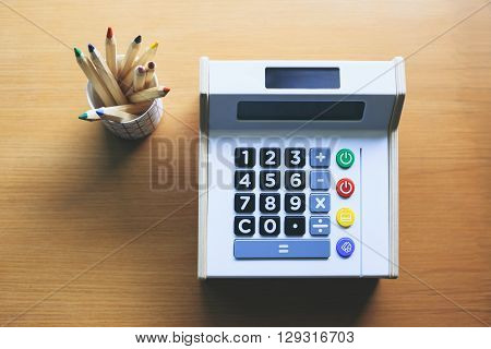Calculator with color pencils on table Money saving Budget control Financial management Startup concept