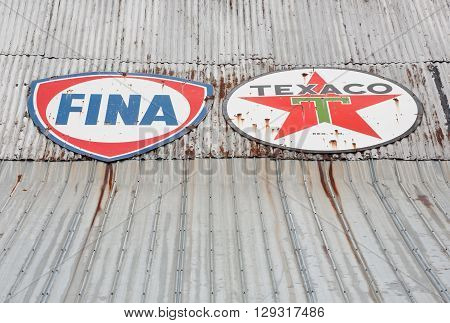 EARLTOWN CANADA - MAY 07 2016: Fina and Texaco signs on metal roof. Petrofina was a Belgian owned oil company. Texaco Inc. is an American oil company and a subsidiary of Chevron Corporation.