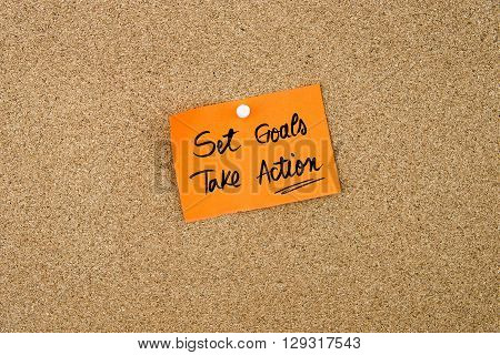 Set Goals Take Action Written On Orange Paper Note