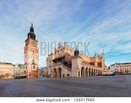 Market square with sukennice and cityhall tower in Krakow at day, Poland