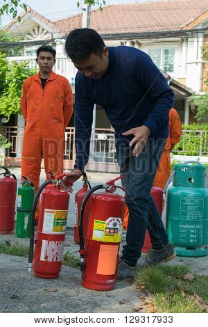 Bangkok Thailand - January 31 2016 : Many people preparedness for fire drill and training to use a fire safety tank in village at Bangkok Thailand.