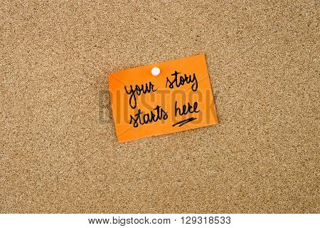 Your Story Starts Here Written On Orange Paper Note