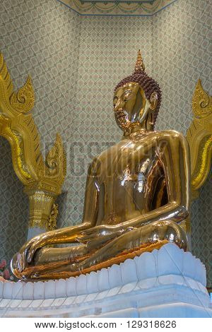 Bangkok Thailand - March 11 2016 : Thai buddha statue at Wat Traimitr Withayaram is a important Thai temple in Chinatown Bangkok Thailand.