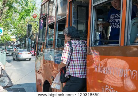 Bangkok Thailand - March 15 2016 : Unidentified people travel by bus in Bangkok. Buses are one of the most important public transport system in Bangkok.
