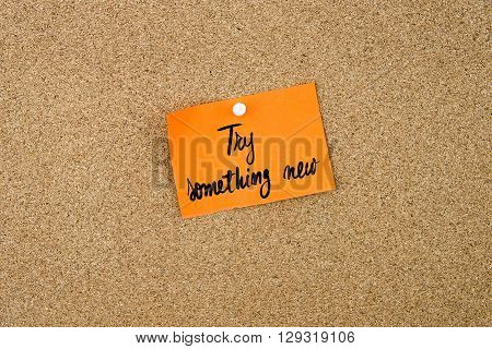Try Something New Written On Orange Paper Note