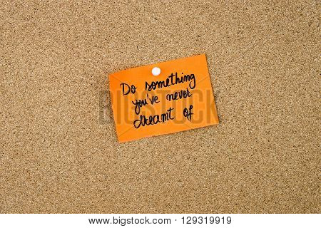 Do Something You've Never Dreamt Of Written On Orange Paper Note