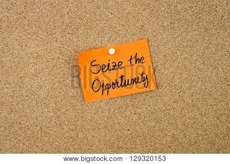 Seize The Opportunity Written On Orange Paper Note