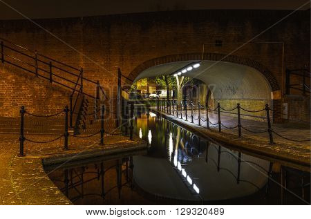 Albion Channel under a path bridge an ornamental canal created linking Canada Water to Surrey Water