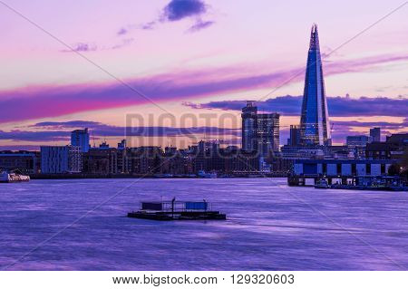 Modern London cityscape during sunset at river Thames