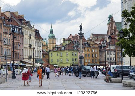 WARSAW - JULY 28: many people walk by pedestrian street in famous Old City district in Warsaw Poland on July 28 2015.