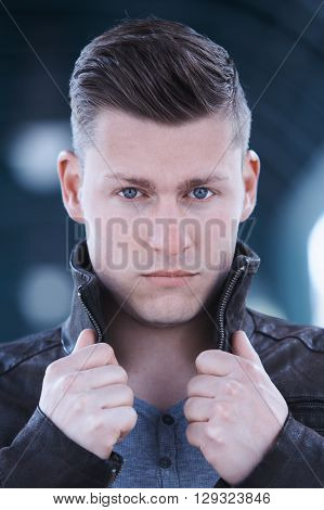 portrait of handsome blond young man looking at camera