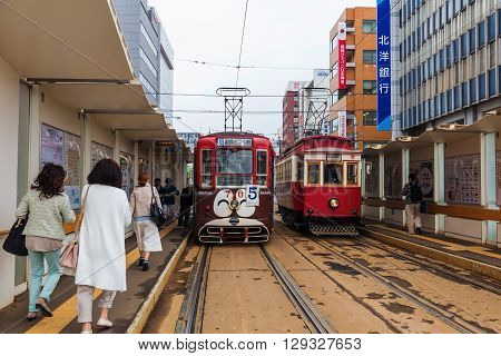 HAKODATE HOKKAIDO - APRIL 22 2016: Unidentified people at Hakodate city Tram station. This tram can bring passengers to all city travel destinations.