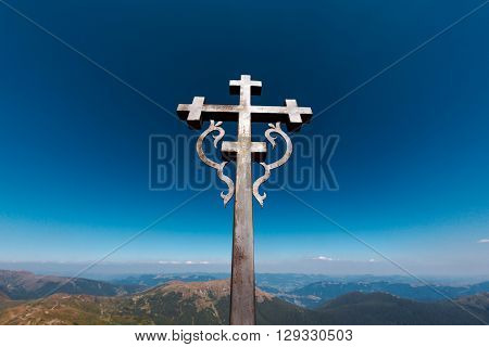 Cross at the top of Pop Ivan, mountain in the Carpathians. Concept of Forgiveness or Mercy , Thanksgiving, Trust or Love