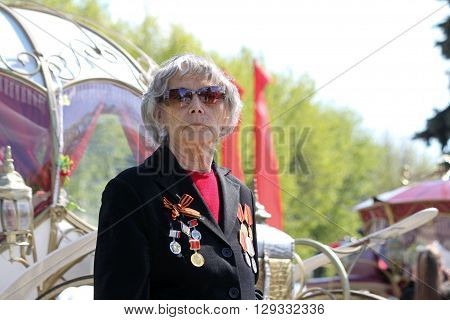 ULYANOVSK, RUSSIA - MAY 9, 2016: An old female veteran takes part at Immortal regiment on 9 May, 2016 in Ulyanovsk, Russia