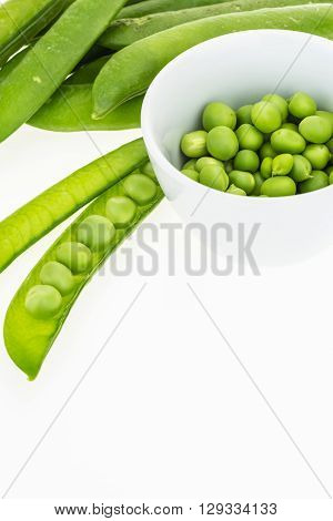 Fresh Green Pea Pods And Peas In Bowl, On White Background With Copy-space