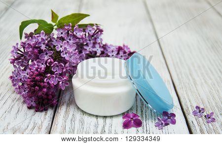 Moisturizing Cream And Lilac Flowers