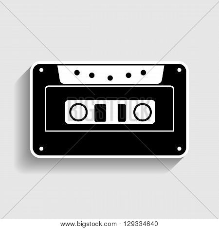 Cassette icon, audio tape sign. Sticker style icon with shadow on gray.