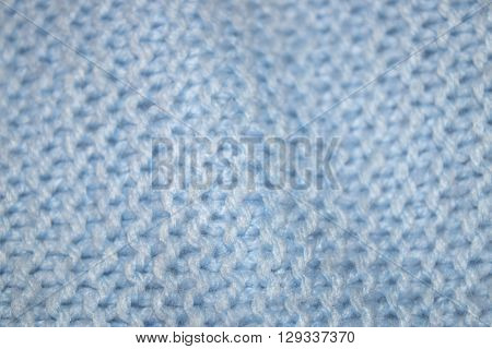 close up knitted texture fabric background in baby blue wool