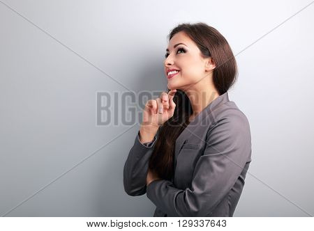 Happy Young Business Woman In Suit Thinking And Looking On Empty Copy Space
