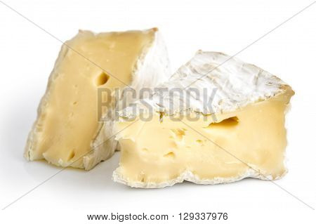 Two Pieces Of White Mould Cheese Isolated On White.